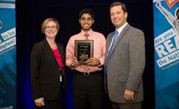 Picture of Ali Kahn at Microsoft Office Specialist US national championship receiving award