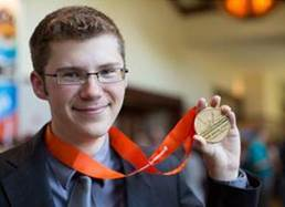 Image of Tyler Millis holding his Microsoft Office Specialist medal